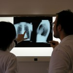 Doctors examine an X-ray for indications of tooharditis. Shows what they know; they're looking in the wrong place.